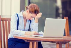 Worried stressed business woman working on computer laptop stock image