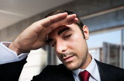 Worried and stressed businessman. Portrait of a worried and stressed businessman Stock Image