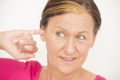 Worried stressed woman finger in ear Stock Photography