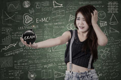 Worried student with bomb of exam Royalty Free Stock Photography