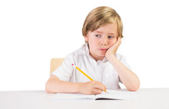 Worried student doing some homework Royalty Free Stock Photo