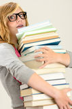 Worried student girl carry stack of books Royalty Free Stock Image