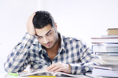 Worried student looking books on white background. Concept of concern Stock Images