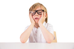 Worried student sitting with glasses Stock Images