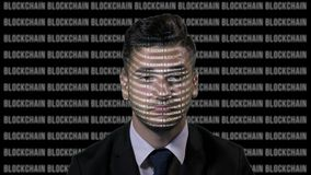 Worried team leader using augmented reality to analyze bitcoin data on a running blockchain black screen background -. Worried team leader using augmented stock footage