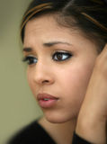 Worried teen girl. Close-up portrait of a worried teen girl Stock Image