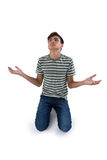 Worried teenage boy praying. Against white background Stock Images