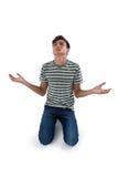 Worried teenage boy praying Stock Images