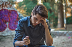 Worried teenage boy thinking how to solve problems stock images