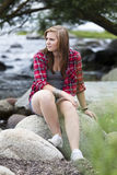Worried Teenage girl. Teenage girl sitting at the water with a worried expression Royalty Free Stock Photography