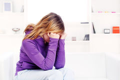 Worried teenage girl at home Royalty Free Stock Photos