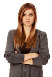 Worried teenage woman with folded arms.  Royalty Free Stock Photo