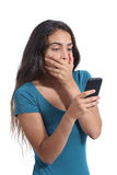 Worried teenager girl looking at smart phone Royalty Free Stock Photos