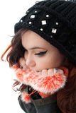 Worried Teenager. Pretty Young worried teenager wearing winter accessories stock image