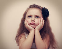 Worried thinking about beautiful long hair girl looking up Royalty Free Stock Photo