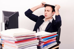 Worried and tired business man with a lot of work. Stock Image
