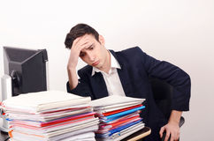 Worried and tired business man with a lot of work. Royalty Free Stock Photography