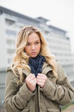 Worried trendy blonde posing outdoors Royalty Free Stock Photography