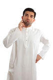 Worried troubled ethnic man wearing a kurta. A middle eastern dressed man wearing a kurta, robe, thobe, is looking quite worried and troubled Stock Photography