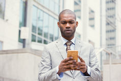 Worried unhappy young man talking texting on phone displeased with conversation Royalty Free Stock Photos