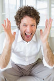 Worried well dressed man shouting at home Stock Photography