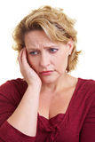 Worried woman. Portrait of a worried woman thinking on isolated background Stock Images