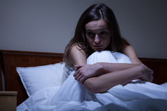 Worried woman in bed Royalty Free Stock Image