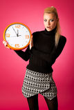 Worried woman with big orange clock gesturing delay, rush, nervo. Us, stress because of lack of time Royalty Free Stock Photography