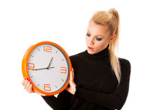 Worried woman with big orange clock gesturing delay, rush, nervo. Us, stress because of lack of time Royalty Free Stock Photos