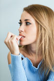 Worried woman biting her nails Royalty Free Stock Photos