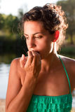 Worried woman biting nails Royalty Free Stock Images