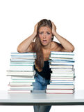 Worried woman with books. Worried woman leaning on pile of books and thinking royalty free stock photography
