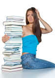 Worried woman with books. Worried woman with pile of books thinking royalty free stock images
