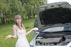 Worried woman with broken car Royalty Free Stock Photography