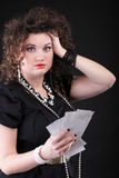 Worried woman calculating her bills Royalty Free Stock Image