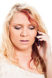 Worried woman calling Stock Images