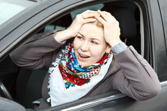 Worried woman in car Stock Photo