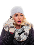 Worried woman on cell phone. A image of a worried woman talking on a cell phone dressed for winter stock photography