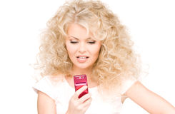 Worried woman with cell phone Royalty Free Stock Images