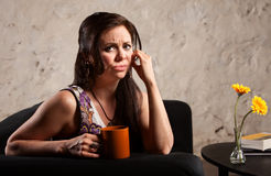 Worried Woman with Cup Stock Photos