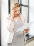 Worried woman with documents Stock Image