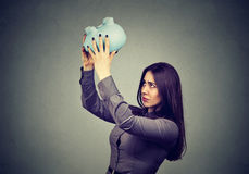 Worried woman with empty piggy bank Royalty Free Stock Photos