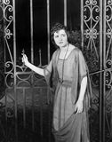 Worried woman at gate Stock Photos