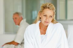 Worried woman with her husband at the back Stock Photography