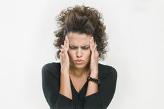 Worried woman holding her head. Picture of worried woman holding her head with her hands Royalty Free Stock Photo