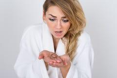 Worried woman holding loss hair stock photo