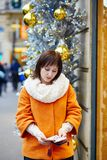 Worried woman holding purse with Russian roubles Stock Photo
