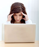 Worried woman with a laptop Stock Image