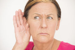 Worried woman listening Royalty Free Stock Image