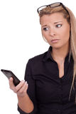 Worried woman looking at her mobile Stock Images